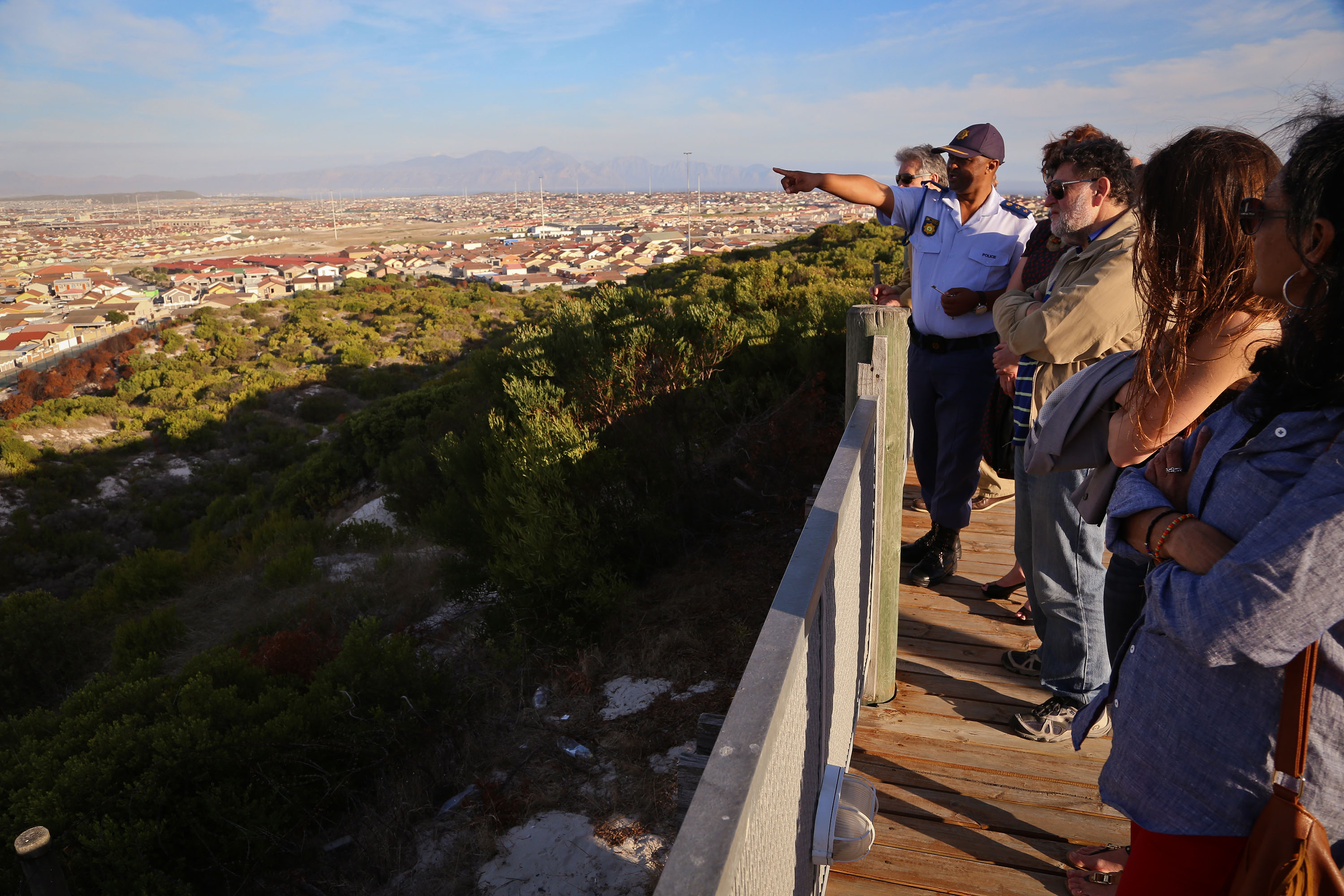 UN experts with police at the Lookout Hill in Khayelitsha